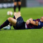 Messi sufriendo una lesión
